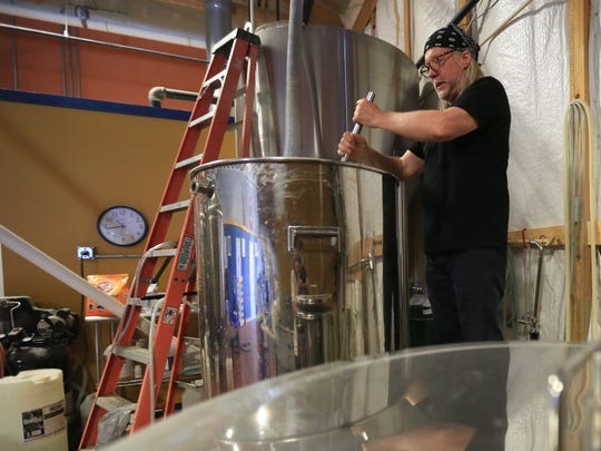 Rob Pfeiffer, a brewer at Smyrna's Blue Earl, prepares a batch of IPA.