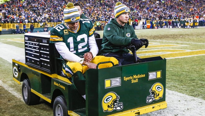 Green Bay Packers quarterback Aaron Rodgers is carted off the field after suffering an injury in the first half against the Detroit Lions at Lambeau Field.