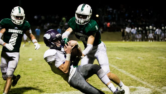Opelousas Catholic wide receiver Cale Cart pulls in a pass in the football game between the Vikings and and Catholic High Point Coupee in New Roads Friday Nov. 3, 2017.