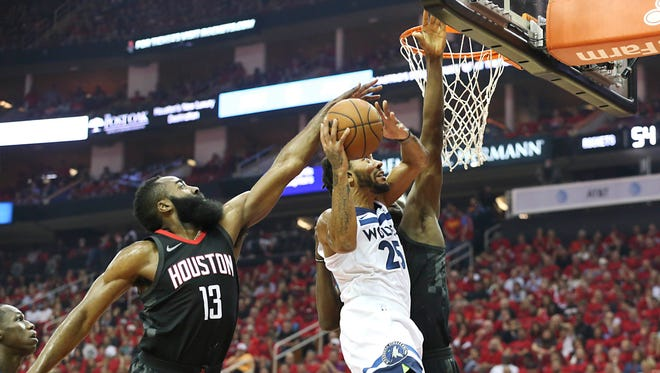 Minnesota Timberwolves guard Derrick Rose has his shot blocked by Houston Rockets guard James Harden in the second half of Game 5.