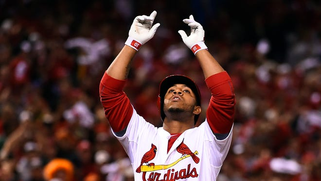 Oct 12, 2014: St. Louis Cardinals pinch hitter Oscar Taveras (18) celebrates after hitting a solo home run against the San Francisco Giants during the 7th inning in game two of the 2014 NLCS playoff baseball game at Busch Stadium.