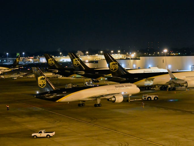 UPS planes line up during night operations at UPS Worldport on the grounds of Louisville International Airport on Dec. 12.