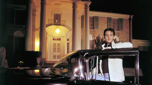 "Elvis Presley posed with one of his cars outside Graceland in this photograph published March 7, 1965, in the first issue of Mid-South, the now-defunct Sunday magazine of The Commercial Appeal. Elvis complained of the long sessions with photographers making movie publicity stills: ""I try to cut the time down to three or four hours, but sometimes you have to pose for six or eight. A man only has so many different smiles, and I don't have many."""
