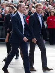 Britain's Prince Harry (R) and his brother Prince William,