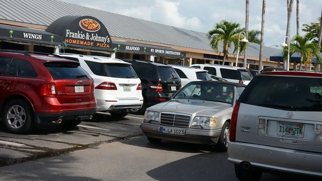 Vehicles jockey for a parking spot at Marco Town Center. Finding sufficient parking spaces is an issue that continues to bedevil the Marco Island community.
