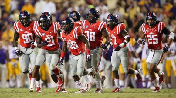 Ole Miss' defense runs off the field after a Mike Hilton interception against LSU
