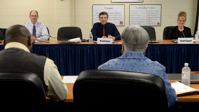 John Weber, left, Ronald Itnyre and Wendi Claywell prepare to give an opening statement Wednesday, March 16, 2016, during the final interviews for the Richmond Community Schools' board of trustees vacant position at the administration building in Richmond.