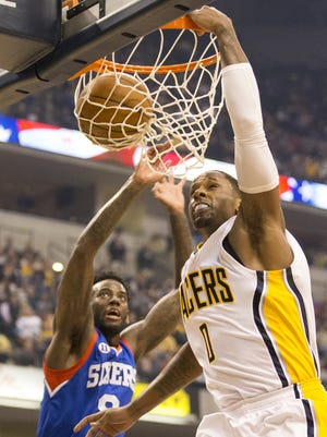 C. J. Miles, shown here making a dunk after being fouled by JaKarr Sampson during the Oct. 29 game, led the Pacers Wednesday night with a season-high 30 points.