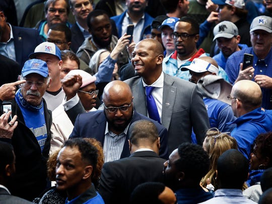 "Former Tiger great Anfernee ""Penny"" Hardaway (middle) greets fans after being introduced as the University of Memphis' new head basketball coach at the Laurie-Walton Family Basketball Center Tuesday morning. Hardaway, who a standout player at the U of M from 91-93, will take over for recently fired head coach Tubby Smith."