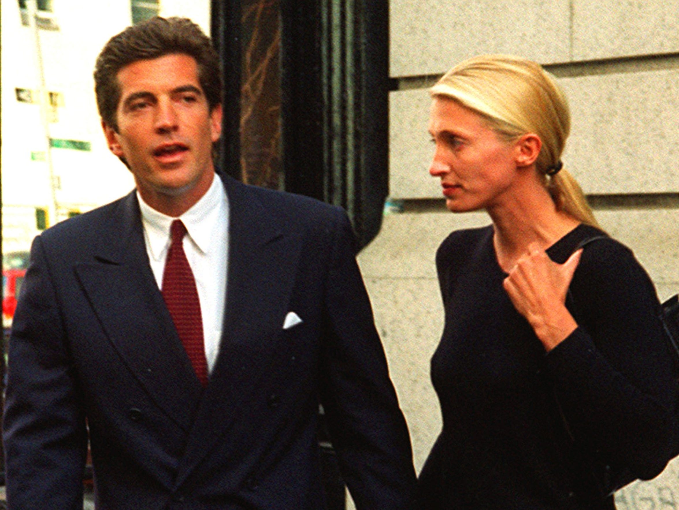 John F. Kennedy Jr., left, and his wife, Carolyn Bessette,