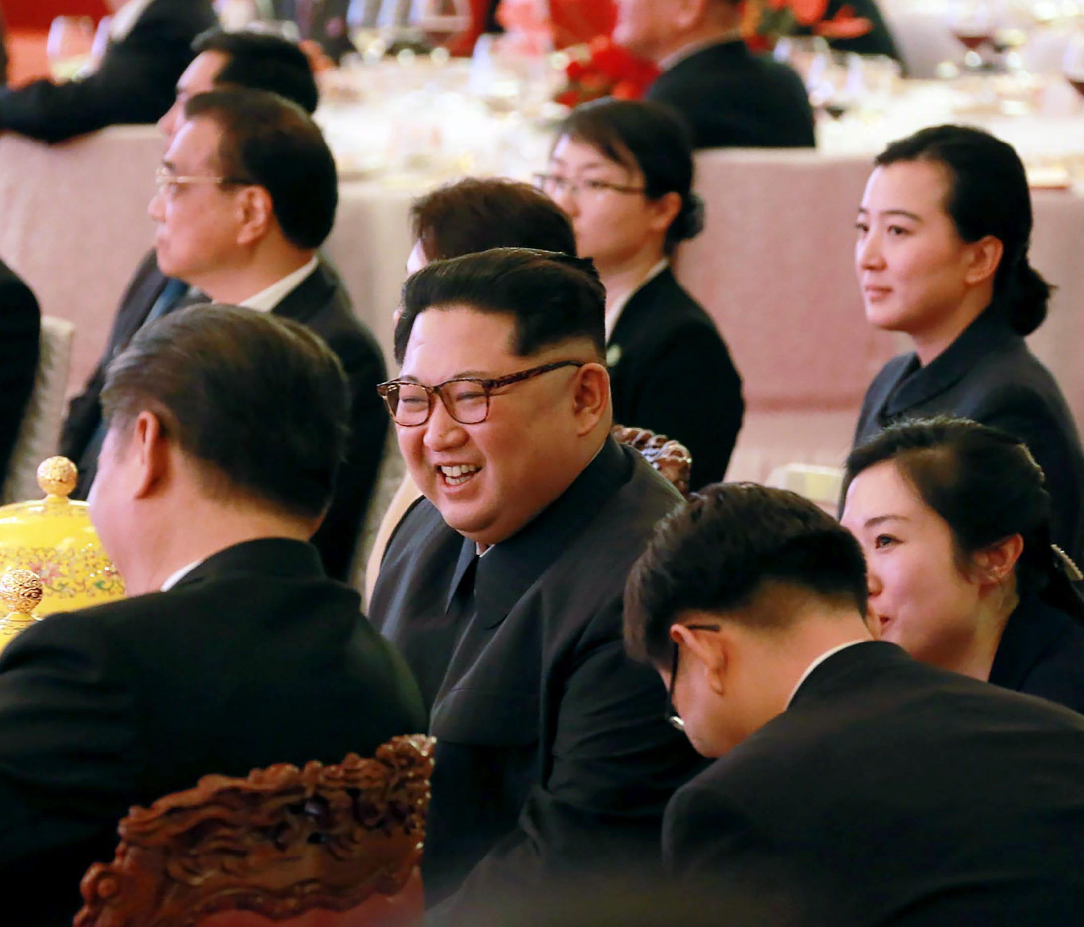 This picture from North Korea's official Korean Central News Agency (KCNA) taken on March 26, 2018 and released on March 28, 2018 shows North Korean leader Kim Jong Un during a dinner banquet at the Great Hall of the People in Beijing.