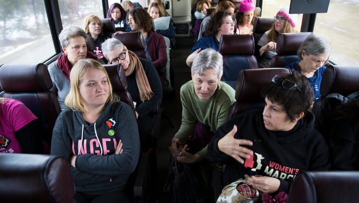 Women ride a bus to Washington for the Women's March