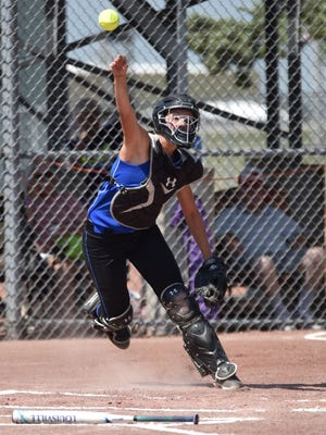 Montezuma catcher Cassidy Watts  throws to the infield during the first round Class 1A softball game against Kee High. Kee won the game 18-1 on Monday, July 17.
