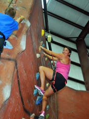On The Edge indoor rock climbing in Melbourne. FLORIDA TODAY's Michelle Mulak (seen here), along with members of the Cocoa Beach Fun Runners & Walkers enjoyed this indoor sport, many for the first time.