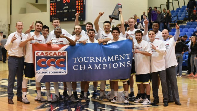 The Corban men's basketball team celebrates winning the Casdcade Collegiate Conference tournament championship on Feb. 28 in Klamath Falls, Ore.