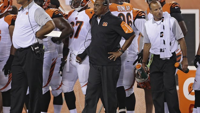 Cincinnati Bengals head coach Marvin Lewis paces the sideline during the second quarter of the NFL pre-season game between the Cincinnati Bengals and the New York Giants at Paul Brown Stadium on Friday, Aug. 14, 2015. At the half, the Bengals led the Giants 17-10.