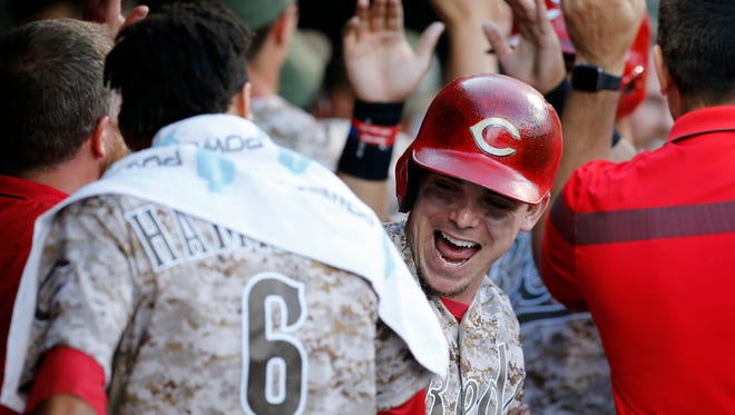 Cincinnati Reds left fielder Scooter Gennett (4) is high fived in the dugout  after hitting a grand slam home run to right-center field in the bottom of the third inning against the St. Louis Cardinals at Great American Ball Park on June 6, 2017.