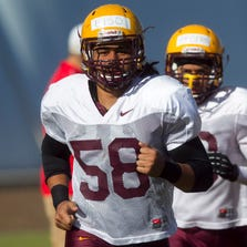 ASU linebacker Salamo Fiso warms up during Spring practice at the Kajikawa practice fields at ASU  in Tempe on Thursday, April 3, 2014.