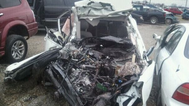 Jantwnette Smith's white Nissan Sentra, after it was hit by a drunken driver Christmas Eve, 2012. Smith, 26, died in the wreckage on Interstate 40 near Germantown Parkway.