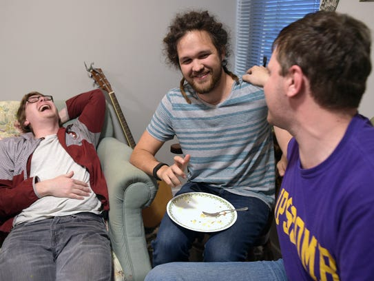 Alex Drury, left, Jordan Collins and Matt Branch laugh