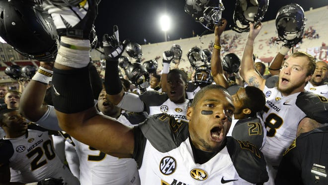 Michael Sam celebrates with his teammates after a game this season. Sam announced that he is gay before the draft.  Mike DiNovo/USA Today Michael Sam celebrates with his teammates after a game this season. Sam announced that he is gay on Sunday.