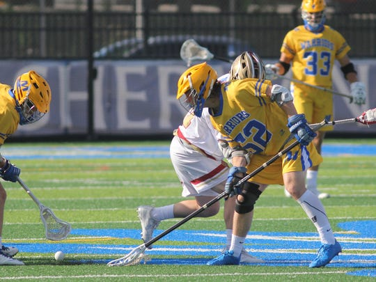 Mariemont's Charles Schooler (52) and   Parker Gilmore battle for the ball during their state semifinal against Bishop Watterson on Wednesday, May, 31, 2017.