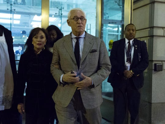 Roger Stone accompanied by his wife Nydia Stone, left, leaves federal court Washington, Thursday, Nov. 14, 2019. (AP Photo/Jose Luis Magana)