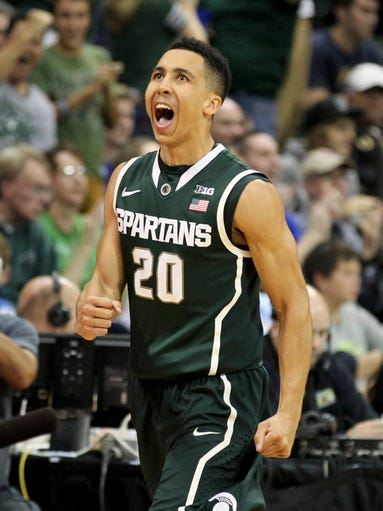 Michigan State guard Travis Trice (20) reacts after