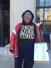 Doris Patrick collects recall signatures outside Tuesday's