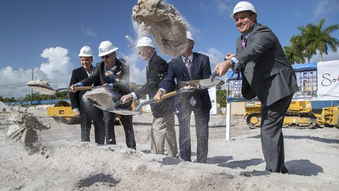 Albert Codoves, President of Corwil Architects; Ondrej David, I.C.P. Investments; Jack Weir, President of Eastwind Development; Mark Marciano, Mayor of Palm Beach Gardens; and Richard A. Giesler, President of Florida Region of M&T Bank (L to R) break ground for Solera at City Center in Palm Beach Gardens last week. The five story, 136-unit, apartment complex will include 14 units set aside for workforce housing.