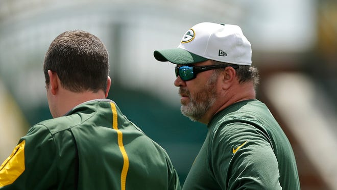 Green Bay Packers head coach Mike McCarthy looks on during organized team activities  at Ray Nitschke Field.