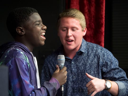Jaycob Johnson, left, and Kolby Atkins rehearse for CTE Goes Live at Stellar Vision and Sound on Tuesday, May 2, 2017.