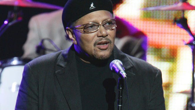 "This Sept. 20, 2005 file photo shows singer Art Neville performing during the ""From the Big Apple to the Big Easy"" benefit concert in New York. Neville, a member of one of New Orleans' storied musical families, the Neville Brothers, and a founding member of the groundbreaking funk band The Meters, has died at age 81."