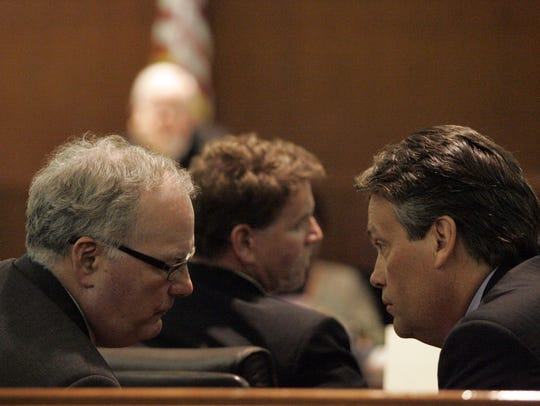 Defense attorneys Mark Foster (left) and Roger Tansey