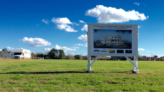 A sign identifies where the new building for Trahan Real Estate Group will be going up soon.