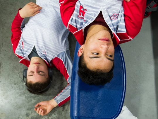 Heritage wrestlers Joey Ahern, left, and Brayan Sanchez rest during the individual regionals Saturday at Hardin Valley Academy.