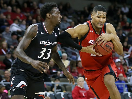 Cincinnati Bearcats forward Kyle Washington (24) drives to the basket as Cincinnati Bearcats center Nysier Brooks (33) defends in the first half during the Cincinnati Bearcats red versus black men's basketball scrimmage, Saturday, Oct. 28, 2017, at BB&T Arena in Highland Heights, Ky.