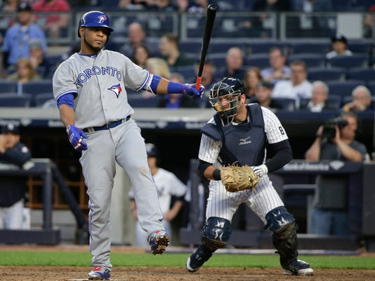 Toronto Blue Jays designated hitter Edwin Encarnacion reacts after striking out against the New York Yankees during the third inning of a baseball game, Tuesday, May 24, 2016, in New York. (AP Photo/Julie Jacobson)
