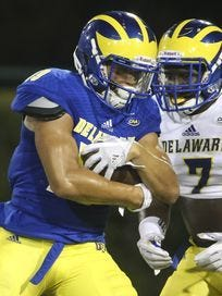 Freshman receiver Gene Coleman II pulls in a catch with Ray Jones covering in a recent Delaware scrimmage.