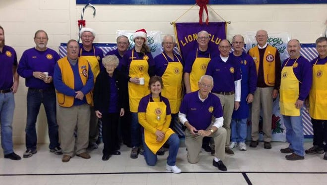 Photo of the Sturgeon Bay Lions Club volunteers at the 2016 Breakfast with Santa.