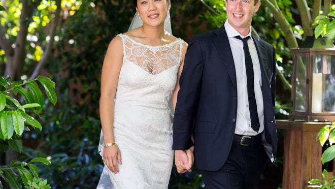 Facebook founder and CEO Mark Zuckerberg and Priscilla Chan are seen at their wedding ceremony in 2012. Zuckerberg and his wife are making the $25-million grant to the Centers for Disease Control and Prvention's foundation from their fund at the nonprofit Silicon Valley Community Foundation.