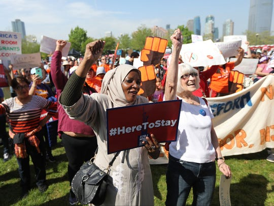 Mariam Souleyman, originally from Chad, was among the hundreds who attended a May Day rally at Liberty State Park in Jersey City on Monday.