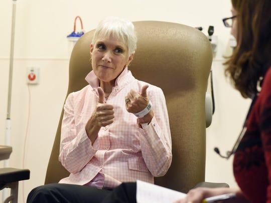 Cancer survivor Sandy Hillburn gives a thumbs up in