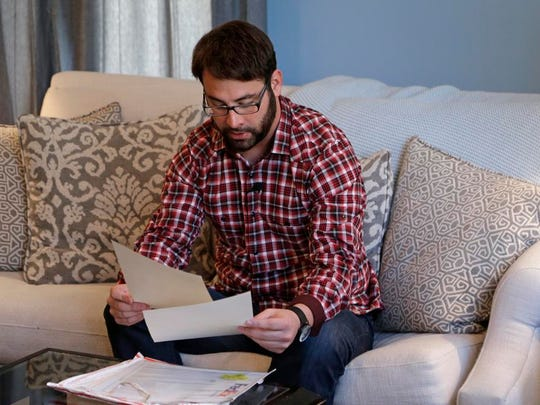 Jamey Anderson reads the letter to his grandfather, front, that was returned to him unopened during an interview in Charlotte, N.C. After breaking with Word of Faith, Anderson lost all contact with his mother and brother, who remain in the church. He said church co-founder Jane Whaley even refused to let him attend the funeral of his grandfather, the most important male figure in his childhood, and that he was omitted from the list of family members in the obituary.