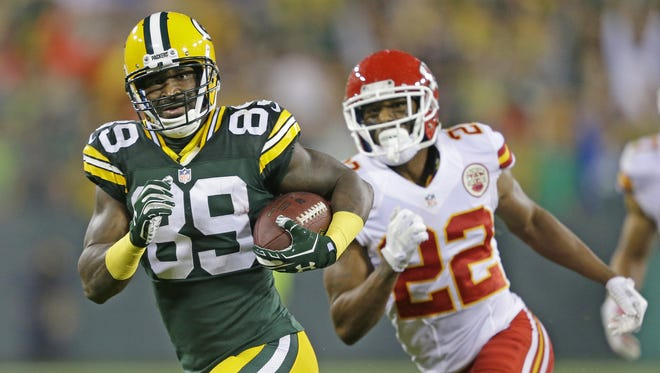 Green Bay Packers wide receiver James Jones (89) runs after a catch against cornerback Marcus Peters (22) of the  Kansas City Chiefs at Lambeau Field.