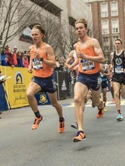 Sam Parsons (left) and Drew Hunter (right) compete at the B.A.A. Invitational Mile in Boston, Massachusetts.