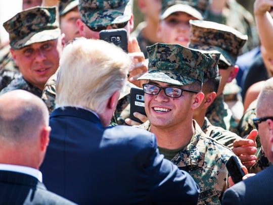 President Donald Trump greets Marines at the Marine