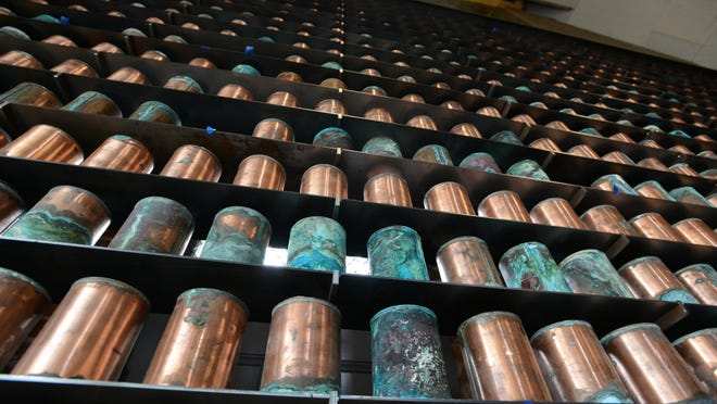 The original copper canisters that once housed the cremated remains of Oregon State Hospital patients are displayed.