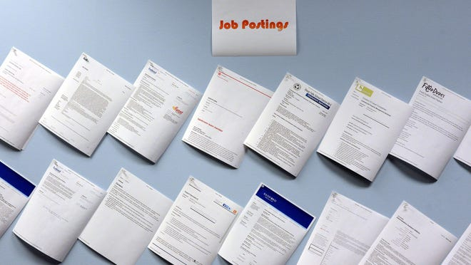 Job listings line a wall in a career center Capital One Financial Corp. set up for its employees who will be out of work when the Sioux Falls operation closes by the end of the year.