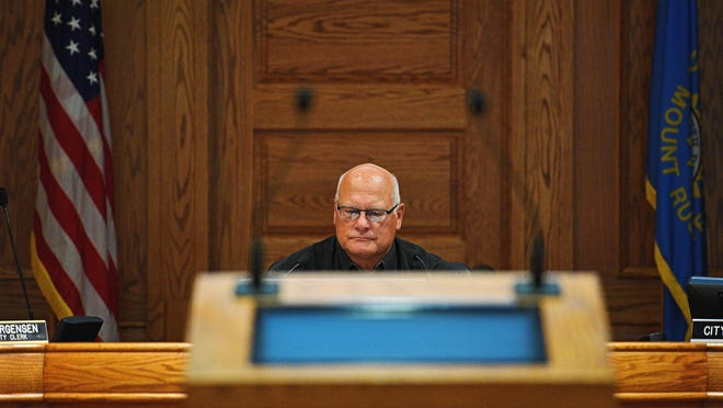 Sioux Falls City Council Chair Rex Rolfing listens as fellow City Council member Theresa Stehly apologizes to the City Council after being gaveled down last week during a City Council meeting Tuesday, Sept. 27, 2016, at Carnegie Town Hall in downtown Sioux Falls.